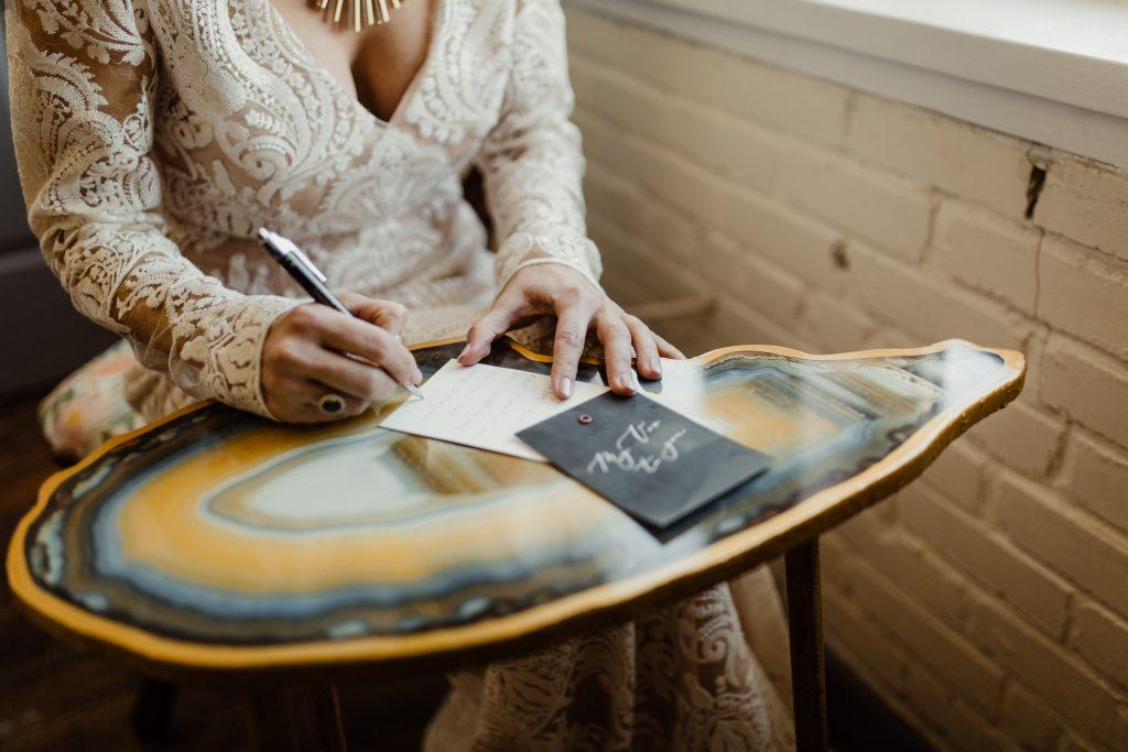 Bohemian Romance Surprise Vow Renewal - Bride writing her vows